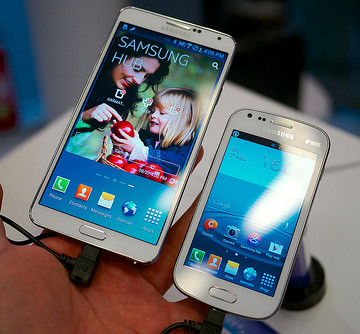 At left: Samsung Note 3, a phablet that's not stupid enough to call itself that.